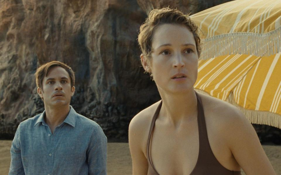 Gael García Bernal and Vicky Krieps discover that their beach holiday is far from idyllic - Universal