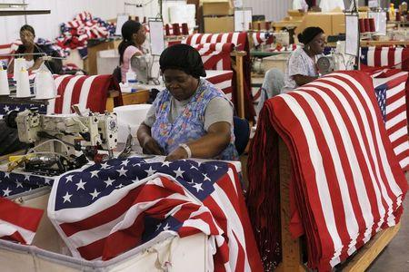Daisy Nesmith sews U.S. flags at Valley Forge's manufacturing facility in Lane, South Carolina June 23, 2015. REUTERS/Brian Snyder