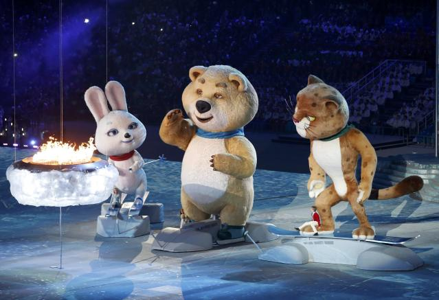 Olympic Games mascots extinguish the Olympic flame in a small cauldron in the stadium, during the closing ceremony for the 2014 Sochi Winter Olympics, February 23, 2014. REUTERS/Grigory Dukor (RUSSIA - Tags: OLYMPICS SPORT)