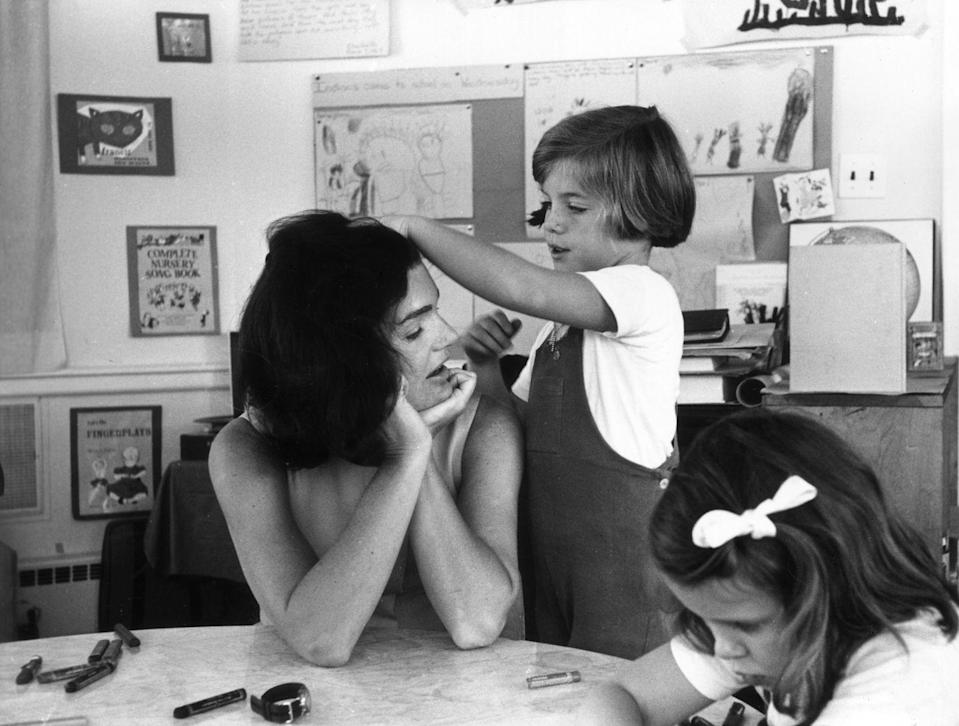 <p>Jackie sits in a classroom while visiting daughter Caroline's school. </p>