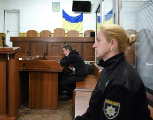 A suspected attacker on a Roma camp in Ukraine attends a court hearing June 25 near the city of Lviv. The first fatal attack on Ukraine's Roma population in years left one man dead and four more hospitalised on Saturday