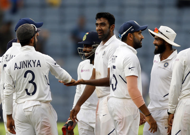 Indian cricketer Ravichandran Ashwin celebrates after the dismissal of Keshav Maharaj during the third day of the second cricket test match between India and South Africa in Pune, India, Saturday, Oct. 12, 2019. (AP Photo/Rajanish Kakade)