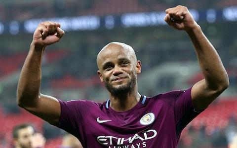 """Vincent Kompany has challenged his Manchester City team-mates to usher in a period of domestic dominance after Pep Guardiola's side were unexpectedly crowned champions with five matches of the season to spare on Sunday. Guardiola was playing golf with Tommy Fleetwood, the world No 12, and his son Marius at Sandiway in Cheshire when news filtered through that Manchester United had slumped to a miserable 1-0 defeat to bottom club West Bromwich Albion at Old Trafford to guarantee their rivals the title. It evoked memories of Sir Alex Ferguson, the former United manager, being on the golf course when he heard his team had clinched their first Premier League title following Oldham Athletic's victory at Aston Villa in May 1993. City's 3-1 victory away to Tottenham Hotspur on Saturday evening left United needing to avoid defeat to West Brom to delay their rivals' title coronation, but Jose Mourinho's side surrendered in abject fashion, Jay Rodriguez's 73rd-minute goal handing Guardiola his seventh title in nine seasons and City their third in seven. City could become the first Premier League club to reach the 100-point barrier should they claim 13 points from their final five games and need just nine to surpass Chelsea's record haul of 95 in 2004-05. Vincent Kompany wants to ensure there's no let up in their pursuit of silverware Credit: Getty Images But Kompany, the City captain, has already turned his sights to next season by urging the club to ensure there is no let-up in their pursuit of silverware. City's title defences after their successes in 2012 and 2014 ended in disappointment and the Belgian – the club's longest serving player – is determined to go one better next time around. """"You can't take it for granted. I've never been able to retain a title and I want to see if this team can be even more successful,"""" Kompany, who watched the game in the living room of his wife Carla's grandmother's house, said. """"I have been lucky to win three but so many I have missed. I s"""