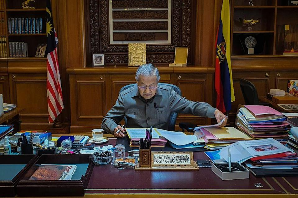 Interim prime minister Tun Dr Mahathir Mohamad gets down to business at Perdana Putra February 25, 2020. — Picture via Twitter