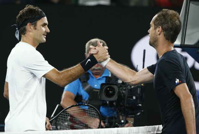Tennis - Australian Open - Rod Laver Arena, Melbourne, Australia, January 20, 2018. Roger Federer of Switzerland shakes hands with Richard Gasquet of France after Federer won their match. REUTERS/Thomas Peter