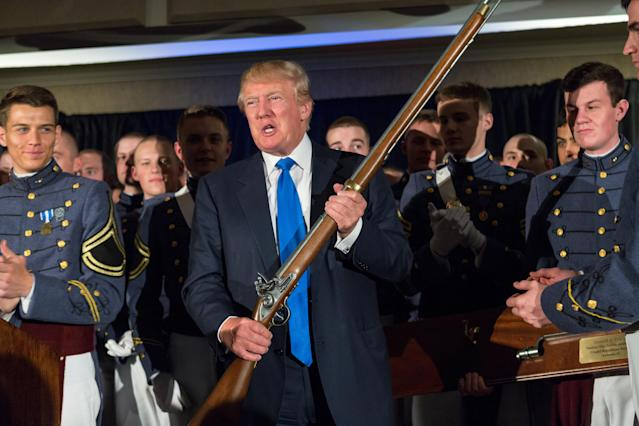 Donald Trump holds a replica flintlock rifle given to him by cadets during the Republican Society Patriot Dinner at the Citadel, the Military College of South Carolina, on Feb. 22, 2015, in Charleston, S.C. Trump and Sen. Tim Scott, R-S.C., were honored at the annual event. (Photo by Richard Ellis/Getty Images)