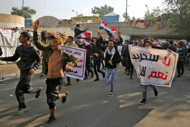 Iraqi supporters of the Iran-trained Hashed al-Shaabi paramilitary force join protesters in Baghdad's Tahrir Square in what is widely seen as an act of intimidation