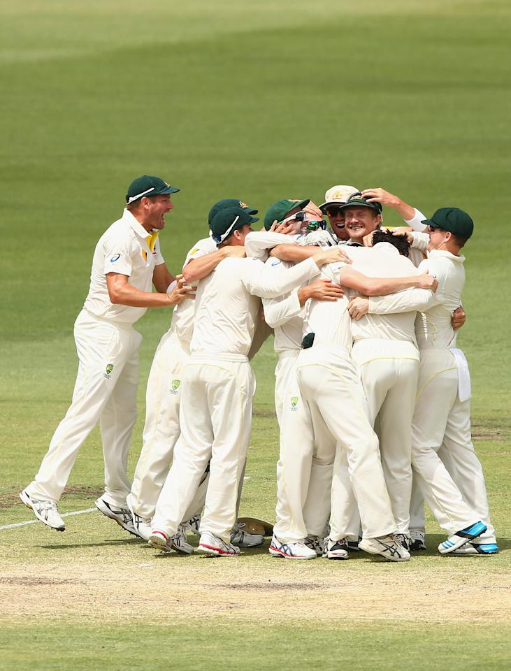 PERTH, AUSTRALIA - DECEMBER 17:  Australian players celebrate after they defeated England during day five of the Third Ashes Test Match between Australia and England at WACA on December 17, 2013 in Perth, Australia.  (Photo by Robert Cianflone/Getty Images)