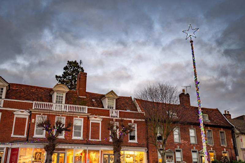 Framlingham in Suffolk's flag pole as a Christmas tree. December 13, 2019. Residents in Ed Sheeran's home town were left disappointed earlier this week when their traditional Christmas tree was replaced - by a flagpole wrapped in tinsel. See SWNS story SWCAtree. Locals in quaint Framlingham, Suffolk, gather every year for 'Festive Fram' - the switching on of festive lights around a huge Scandinavian Christmas tree. However this year revellers were left spluttering in their mulled wine when they discovered the centrepiece of the celebration was actually a spartan flag-pole. The traditional tree, paid for by local businesses, had failed to arrive after another fir fell on the delivery driver and left him hospitalised, they were told. A replacement was ordered but also failed to arrive. Determined not to let the accident spoil the event, the business association came up with the idea of erecting a flag-pole with a star on top and stringing some lights on it. However some residents took to social med