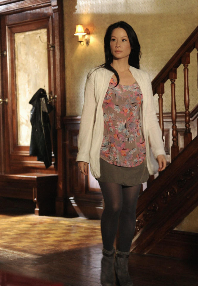 """""""The Woman"""" - As Sherlock reels at the reappearance of his former lover, Irene Adler, a series of flashbacks unravel the tumultuous events that led to his downfall into addiction. Also pictured is Lucy Liu, on the two hour season finale of """"Elementary."""""""