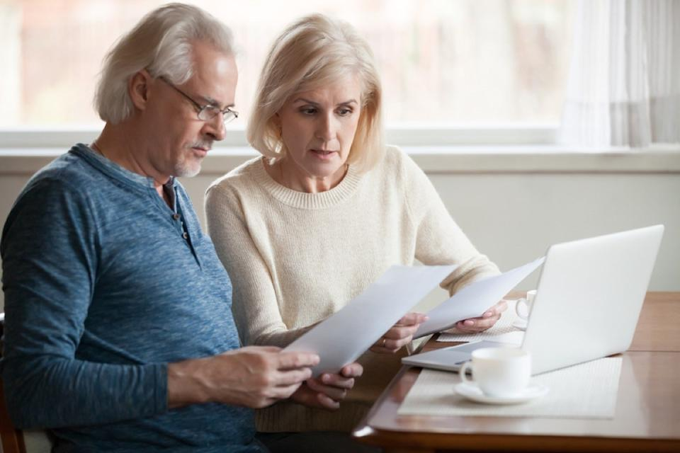 older couple going over financial documents, empty nest
