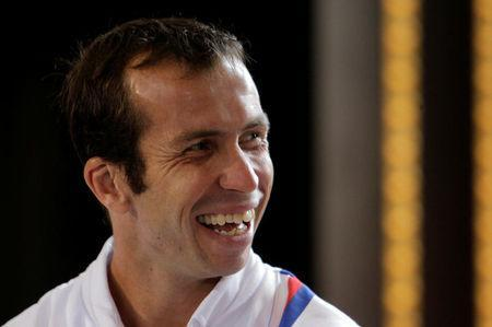 FILE PHOTO: Czech Republic's Radek Stepanek smiles during the draw for the Davis Cup semifinals in Prague September 12, 2013. REUTERS/David W Cerny/File Photo