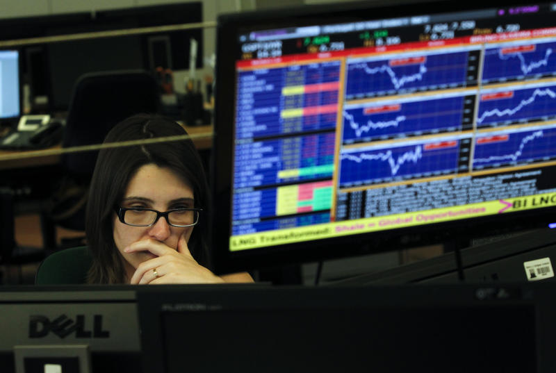 A broker works in a trading room of a Portuguese bank in Lisbon, Wednesday, July 3, 2013. Portugal's financial markets went into a steep nosedive Wednesday as the government teetered on the verge of collapse, alarming investors and reigniting concerns about the eurozone's strategy for dealing with its prolonged financial crisis. Prime Minister Pedro Passos Coelho defied calls to resign late Tuesday but he was running out of options to keep his center-right coalition government together following the resignations of key ministers in a spat over austerity. (AP Photo/Francisco Seco)