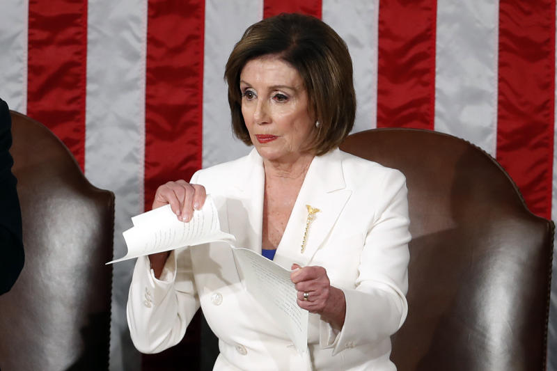 House Speaker Nancy Pelosi tears her copy of President Trump's State of the Union address after he delivered it to a joint session of Congress on Tuesday. (AP Photo/Alex Brandon)
