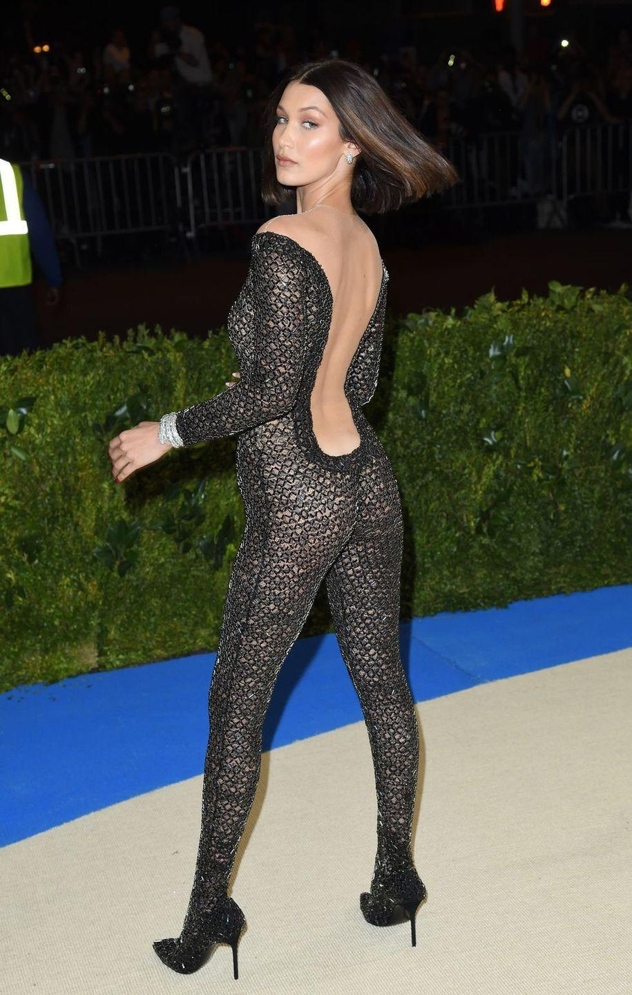 """<p>Ok, this technically isn't a naked dress but who could forget the sheer Alexander Wang catsuit Bella Hadid wore to the <a href=""""https://www.cosmopolitan.com/uk/fashion/celebrity/g9589299/met-gala-red-carpet-dresses-2017/"""" rel=""""nofollow noopener"""" target=""""_blank"""" data-ylk=""""slk:2017 Met Gala"""" class=""""link rapid-noclick-resp"""">2017 Met Gala</a>? Answer: no one.</p>"""