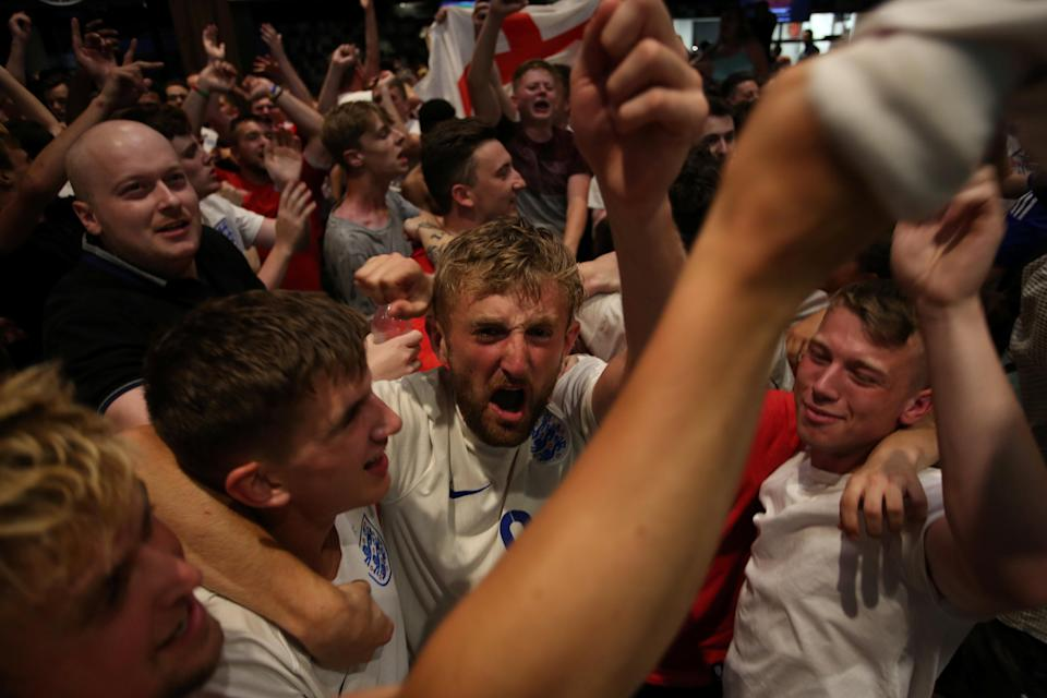 <p>Plenty of people ended up showering in beer after the tense shootout. (Picture: SWNS) </p>