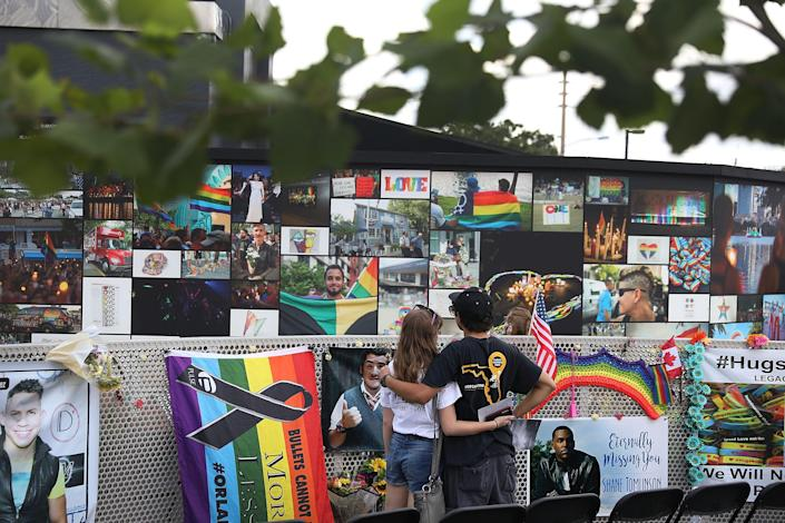 Jillienne Riethmiller, left, and Zachary Guadalupe spend time at the memorial set up for the shooting victims at Pulse nightclub where the shootings took place. On June 12, 2016, a mass shooting took place at Pulse nightclub killing 49 people and wounding 53 in one of the worst mass shootings in U.S. history.