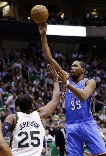 Oklahoma City Thunder's Kevin Durant (35) shoots as Utah Jazz's Al Jefferson (25) defends in the first quarter during an NBA basketball game, Tuesday, April 9, 2013, in Salt Lake City. (AP Photo/Rick Bowmer)