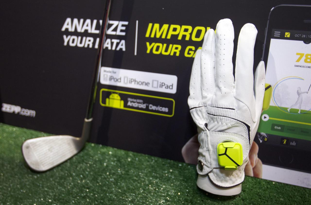 "A Zepp sensor is shown on a golf glove during ""CES Unveiled,"" a media preview event to the annual Consumer Electronics Show (CES), in Las Vegas, Nevada, January 5, 2014. The sensors, available for golf, baseball and tennis, analyze 1,000 data points per second to create 3D representations of a player's swing, a representative said. The sensors retail for $149.99, he said. REUTERS/Steve Marcus (UNITED STATES - Tags: BUSINESS SCIENCE TECHNOLOGY)"