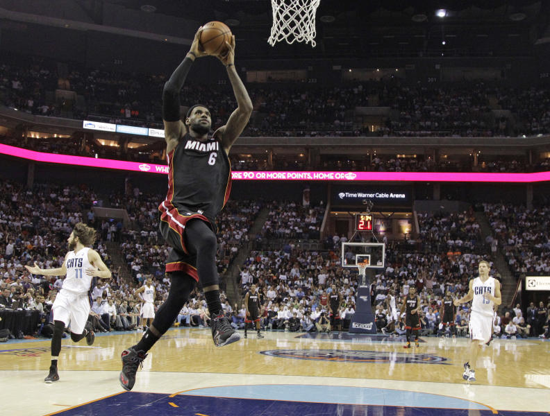 Miami Heat's LeBron James (6) goes up to dunk against the Charlotte Bobcats during the first half in Game 4 of an opening-round NBA basketball playoff series in Charlotte, N.C., Monday, April 28, 2014. (AP Photo/Chuck Burton)
