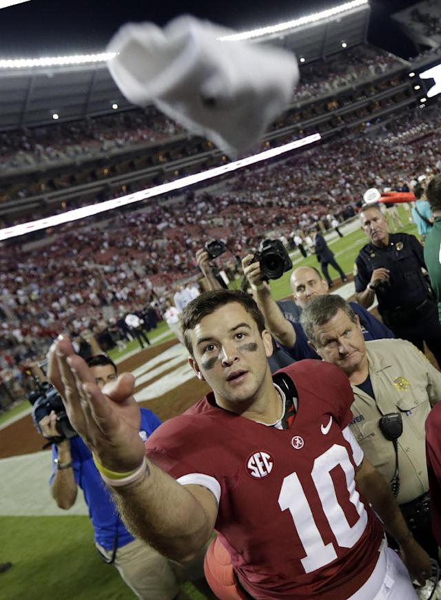 Alabama quarterback AJ McCarron (10) throws his wrist band to the crowd after an NCAA college football game against Mississippi in Tuscaloosa, Ala., Saturday, Sept. 28, 2013. Alabama beat Mississippi 25-0. (AP Photo/Dave Martin)