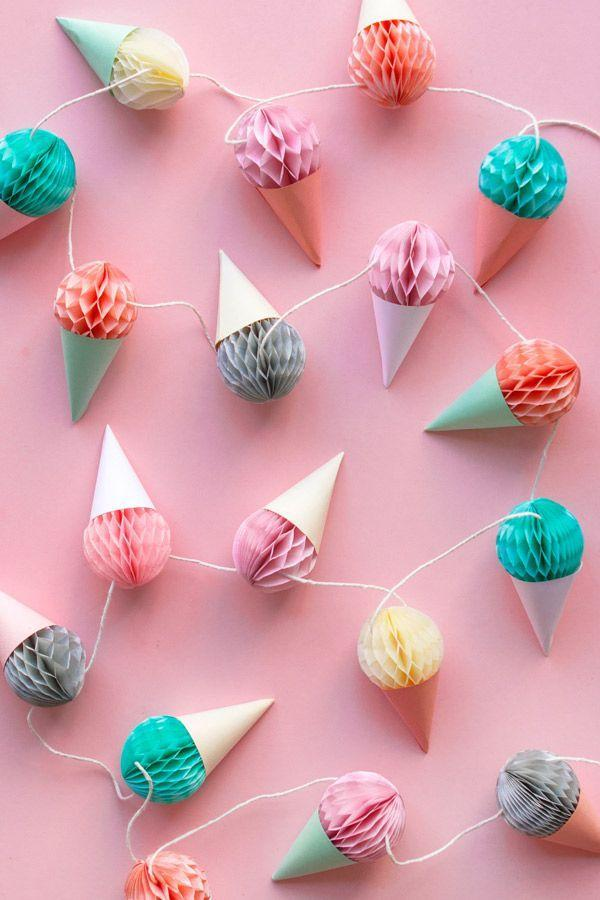 """<p>When you stick mini honeycomb balls into cardstock cones, they look just like little ice cream cones, which you can string up along a wall, table, or stair bannister. </p><p><strong><em><a href=""""https://ohhappyday.com/2015/09/diy-mini-honeycomb-ice-cream-garland/"""" rel=""""nofollow noopener"""" target=""""_blank"""" data-ylk=""""slk:Get the tutorial at Oh Happy Day"""" class=""""link rapid-noclick-resp"""">Get the tutorial at Oh Happy Day</a>. </em></strong></p><p><a class=""""link rapid-noclick-resp"""" href=""""https://www.amazon.com/Honeycomb-Decoration-Birthday-Wedding-Multi-Color/dp/B083R5H2HQ?tag=syn-yahoo-20&ascsubtag=%5Bartid%7C10070.g.37055923%5Bsrc%7Cyahoo-us"""" rel=""""nofollow noopener"""" target=""""_blank"""" data-ylk=""""slk:SHOP HONEYCOMB BALLS"""">SHOP HONEYCOMB BALLS</a></p>"""