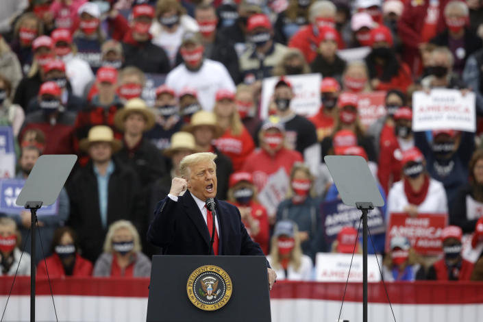 President Donald Trump gestures during a campaign rally at Lancaster Airport, Monday, Oct. 26, 2020 in Lititz, Pa. (AP Photo/Jacqueline Larma)