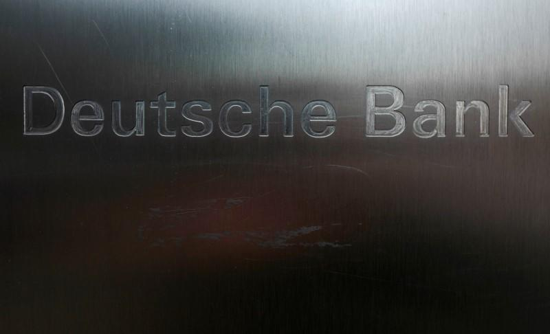 Scratches are seen on the logo of Germany's Deutsche Bank in Frankfurt