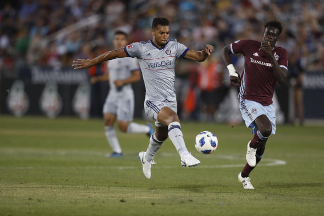 Chicago Fire defender Johan Kappelhof (4) and Colorado Rapids forward Dominique Badji (14) in the second half of an MLS soccer match Wednesday, June 13, 2018, in Commerce City, Colo. The teams played to a 2-2 tie. (AP Photo/David Zalubowski)
