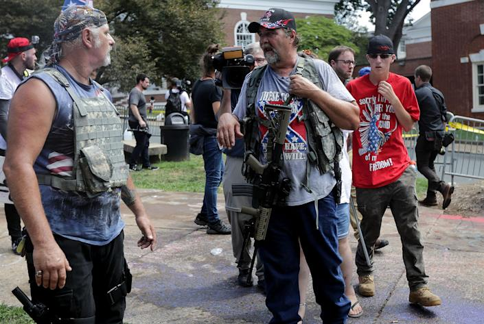 """White nationalists, neo-Nazis, the KKK and other members of the so-called alt-right gather at the """"Unite the Right"""" rally, Aug. 12, 2017, in Charlottesville, Va. (Chip Somodevilla/Getty Images)"""