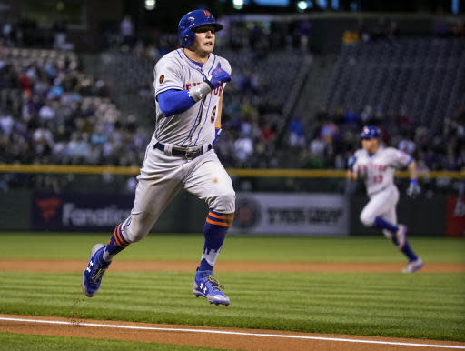 New York Mets' Brandon Nimmo (9) runs home to score on a Todd Frazier sacrifice fly during the first inning of a baseball game, Tuesday, June 19, 2018, in Denver. (AP Photo/Jack Dempsey)