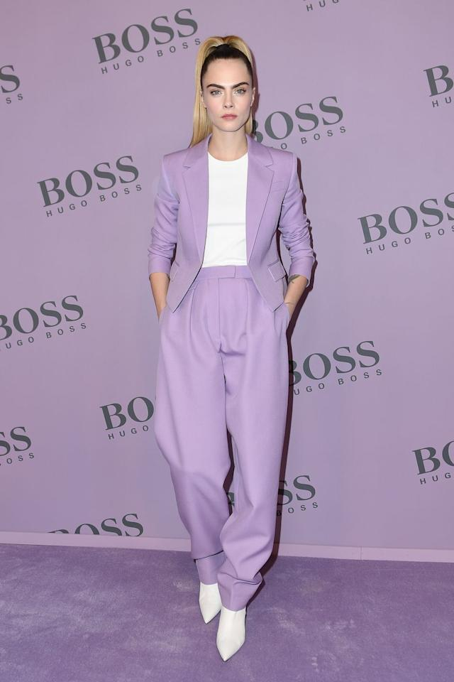 <p><strong>February 2020</strong> Cara Delevingne looked ready for spring in a lilac suit by Boss.</p>