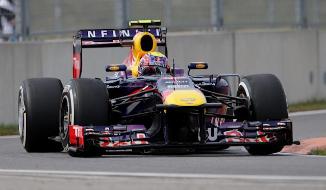 Red Bull driver Mark Webber of Australia steers his car during qualifying at the Korean Formula One Grand Prix at the Korean International Circuit in Yeongam, South Korea, Saturday, Oct. 5, 2013. (AP Photo/Aaron Favila)
