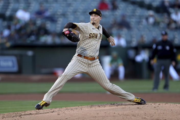 San Diego Padres' Blake Snell throws to an Oakland Athletics batter during the first inning of a baseball game in Oakland, Calif., Tuesday, Aug. 3, 2021. (AP Photo/Jed Jacobsohn)