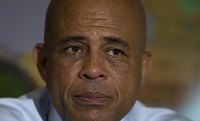 Haiti's President Michel Martelly listens to a question during an interview in Port-au-Prince, Haiti, Friday, May 11, 2012. Despite the nearly 12-month standoff between the Haitian parliament and Martelly, his first year has yielded modest gains despite big obstacles. Asked to name his accomplishments, Martelly pointed out the school-tuition program, the clearing of major camps, the repair of damaged homes and, most controversially, outright evictions from the flimsy shelters of the overcrowded temporary settlements. (AP Photo/Dieu Nalio Chery)