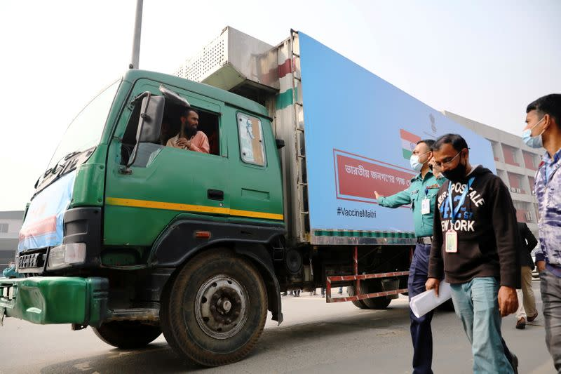 A pickup van carries Oxford-Astrazeneca COVID-19 vaccines which arrived from India as a gift to Bangladesh, in Dhaka