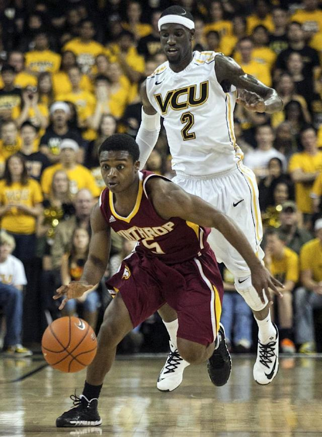 Winthrop guard Keon Moore, front, drives down the court as VCU guard Briante Webber, back, gives chase during the first half of an NCAA college basketball game in Richmond, Va., Saturday, Nov. 16, 2013. (AP Photo/Zach Gibson)