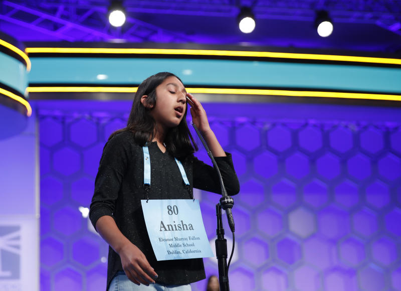"""FILE - In this May 31, 2018 file photo, Anisha Rao, 12, from Dublin, Calif., reacts after spelling a word incorrectly during the evening finals of the Scripps National Spelling Bee in Oxon Hill, Md. An unremarkable sound can be the toughest thing for spellers to master at the Scripps National Spelling Bee. It's known as the schwa. It sounds like """"Uh,"""" and any vowel can make the sound. Spellers have a variety of techniques to figure out unfamiliar schwas, but none of the strategies is foolproof, and sometimes the only things to do are to memorize the word or guess. (AP Photo/Carolyn Kaster)"""
