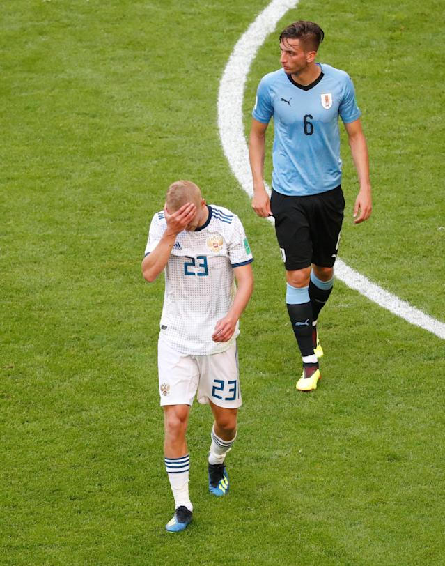 Soccer Football - World Cup - Group A - Uruguay vs Russia - Samara Arena, Samara, Russia - June 25, 2018 Russia's Igor Smolnikov reacts after fouling Uruguay's Diego Laxalt and being shown a second yellow and subsequent red card by referee Malang Diedhiou REUTERS/David Gray