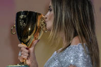 FILE - In this Sept, 11, 2021 file photo Penelope Cruz kisses the Coppa Volpi Best Actress award for 'Parallel Mothers' onstage at the closing ceremony during the 78th edition of the Venice Film Festival in Venice, Italy. (AP Photo/Domenico Stinellis, File)