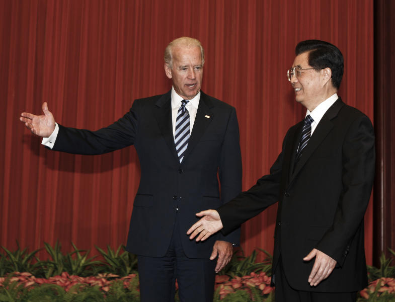 FILE - In this Aug. 19, 2011, file photo, U.S. Vice President Joe Biden, left, chats with Chinese President Hu Jintao before heading to their meeting at the Great Hall of the People in Beijing, China. It's up to Biden to show the U.S. effort to realign its gaze to the East hasn't fizzled out. When he arrives Dec. 2, 2013, in Tokyo on a weeklong trip to Asia, he'll step into a region that's carefully watching to see how committed he and President Barack Obama are to increasing America's influence in Asia, as a hedge against China and its increasing assertiveness. Huddling with foreign leaders in Japan, China and South Korea, Biden will seek to show that despite focusing intensely on Mideast flare-ups and a host of domestic distractions, the U.S. still intends to be a Pacific power. (AP Photo/Andy Wong, Pool)