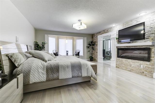 <p><span>158 Wolf Ridge Place Northwest, Edmonton, Alta.</span><br> The master bedroom is located on the main floor. There are six bedrooms in the home in total.<br> (Photo: Zoocasa) </p>