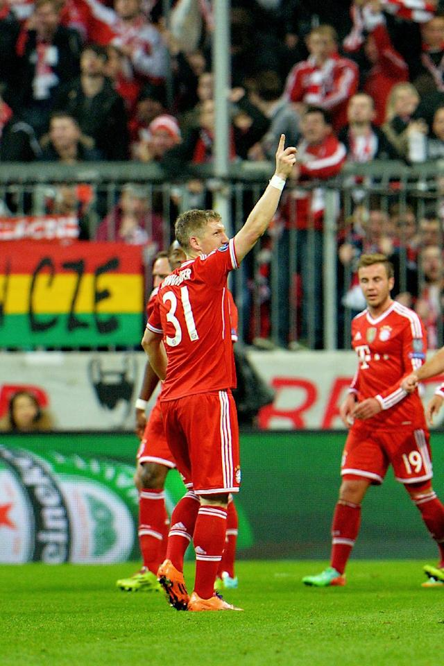 Bayern's Bastian Schweinsteiger celebrates after scoring during the Champions League round of the last 16 second leg soccer match between FC Bayern Munich and Arsenal FC in Munich, Germany, on Tuesday, March 11. 2014. (AP Photo/Kerstin Joensson)