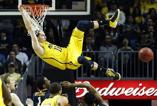 Michigan guard Nik Stauskas watches the ball get away from him following a missed dunk in the first half of an NCAA college basketball game against West Virginia at the Barclays Center, Saturday, Dec. 15, 2012, in New York. (AP Photo/John Minchillo)