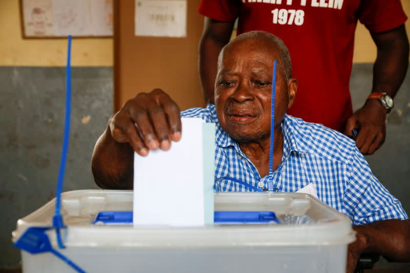 A man casts his ballot at a polling station during the legislative election in Abidjan