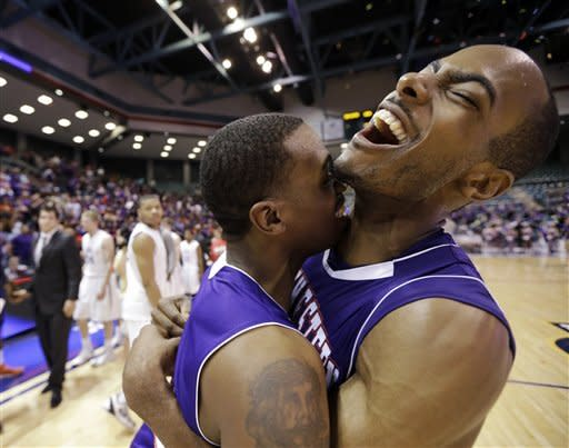 Northwestern State's James Hulbin, right, and Jalan West, left, celebrate after winning the Southland Conference tournament championship basketball game against Stephen F. Austin, Saturday, March 16, 2013, in Katy, Texas. Northwestern State won 68-66. (AP Photo/David J. Phillip)