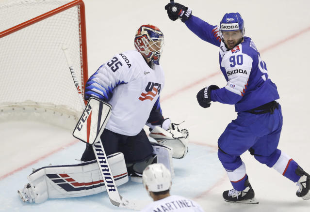 Slovakia's Tomas Tatar, right, celebrates his sides fourth goal past goaltender Cory Schneider of the US, left, during the Ice Hockey World Championships group A match between Slovakia and the United States at the Steel Arena in Kosice, Slovakia, Friday, May 10, 2019. (AP Photo/Petr David Josek)
