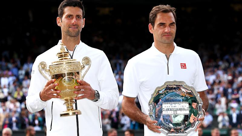 Novak Djokovic and Roger Federer after their epic encounter in the Wimbledon final. (Photo by Clive Brunskill/Getty Images)