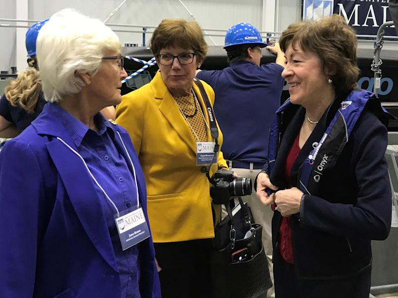 Sen. Susan Collins, R-Maine, right, at the University of Maine on Thursday after the school unveiled the world's largest 3D printer and boat created by a 3D printer.
