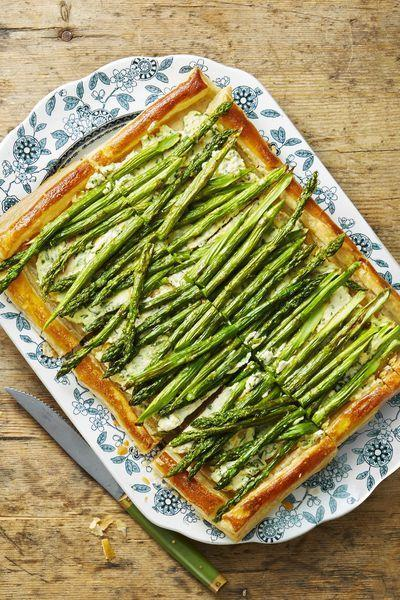 """<p>Your guests will be reaching for seconds after tasting this creamy, flaky veggie tart.</p><p><em><strong>Get the recipe at <a href=""""https://www.goodhousekeeping.com/food-recipes/a48174/roasted-asparagus-and-ricotta-tart-recipe/"""" rel=""""nofollow noopener"""" target=""""_blank"""" data-ylk=""""slk:Good Housekeeping"""" class=""""link rapid-noclick-resp"""">Good Housekeeping</a>.</strong></em></p>"""